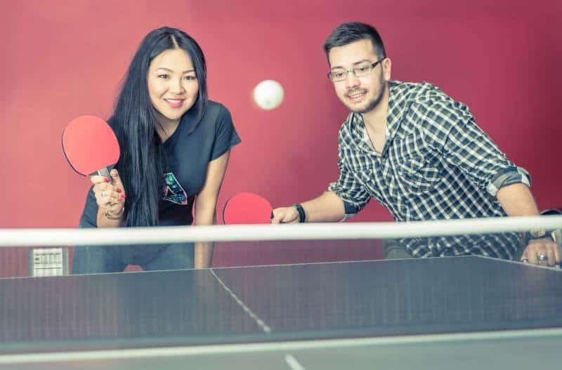 couple playing on mid prince ping pong table